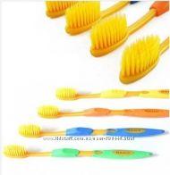 Зубные щетки  с ионами золота.