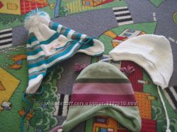 Много разных шапочек от 0 до 3 месяцев.