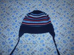 Продаю  демисезонную шапочку фирма TuTu. размер - 44-48.
