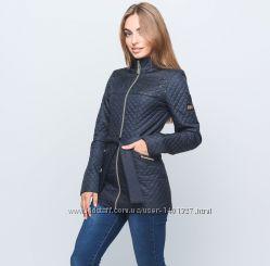 Женская стеганая куртка с кожаной лазерной перфорацией