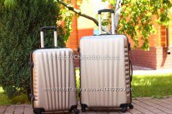 Большой чемодан на 4 колесах пластиковый разные цвета Киев доставка валіза