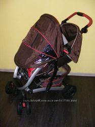 Продам детскую коляску трансформер Graco quattro tour sport бу