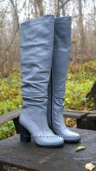 Кожаные сапоги ботфорты на высоком каблуке