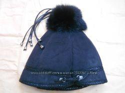 Теплая шапка с натуральным мехом