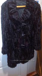 Теплый полушубок из натурального черного каракуля для беременных