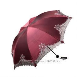 Изысканный женский зонт.
