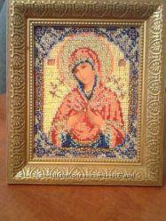 продам икону вышитую бисером Семистрельная Божьей Матери в рамке.