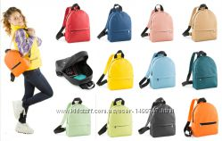Взрослые и детские рюкзаки из кожзама